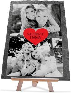 Schieferplatte mit zwei schwaz-weiß-fotos